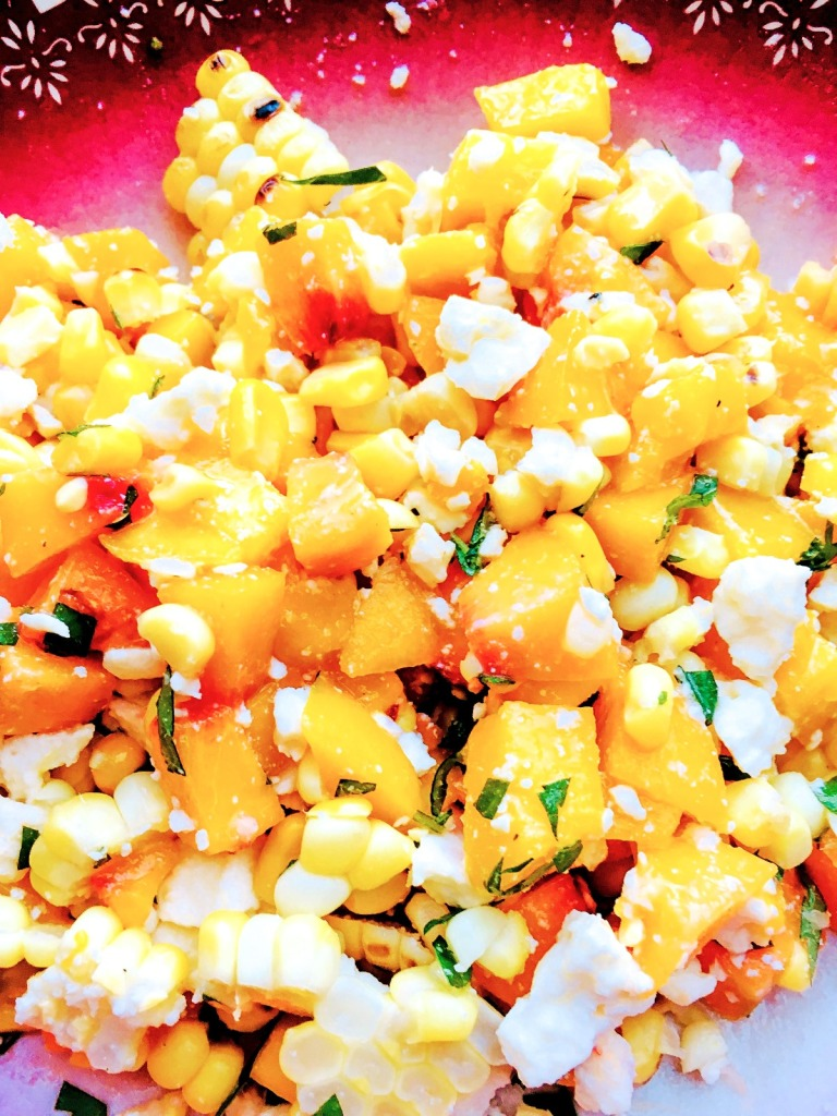 closeup of corn and peach salad