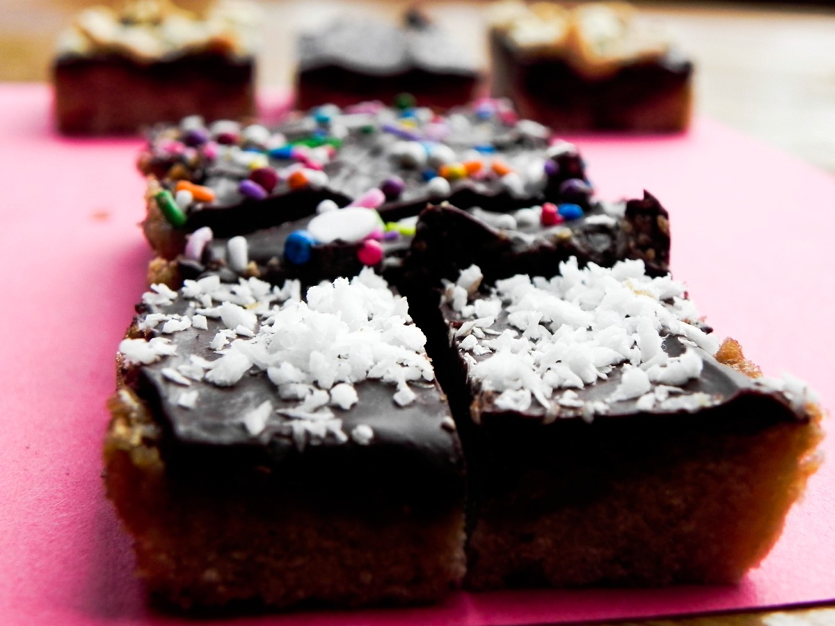 cookie bars with coconut topping and with sprinkles