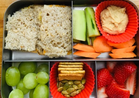 sandwich and mixed snacks with hummus lunchbox