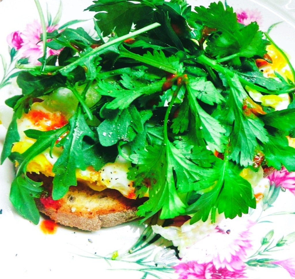 piled herbs sandwich with egg