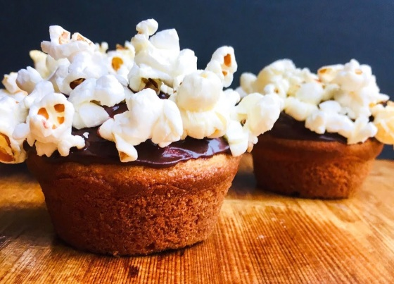 popcorn-topped cupcakes with chocolate icing