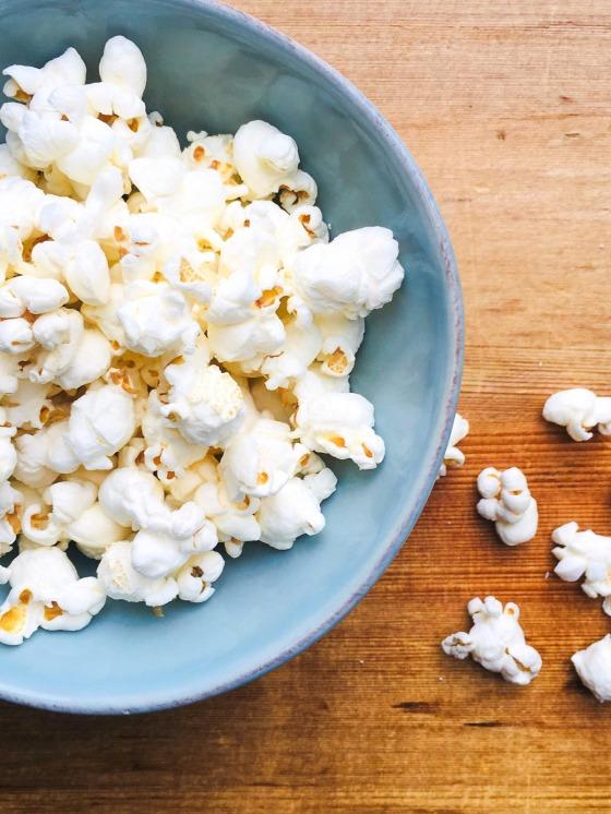 a small blue dish of popcorn
