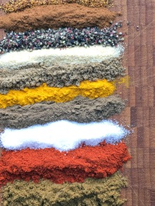 colourful rows of spices used to make a shawarma mix
