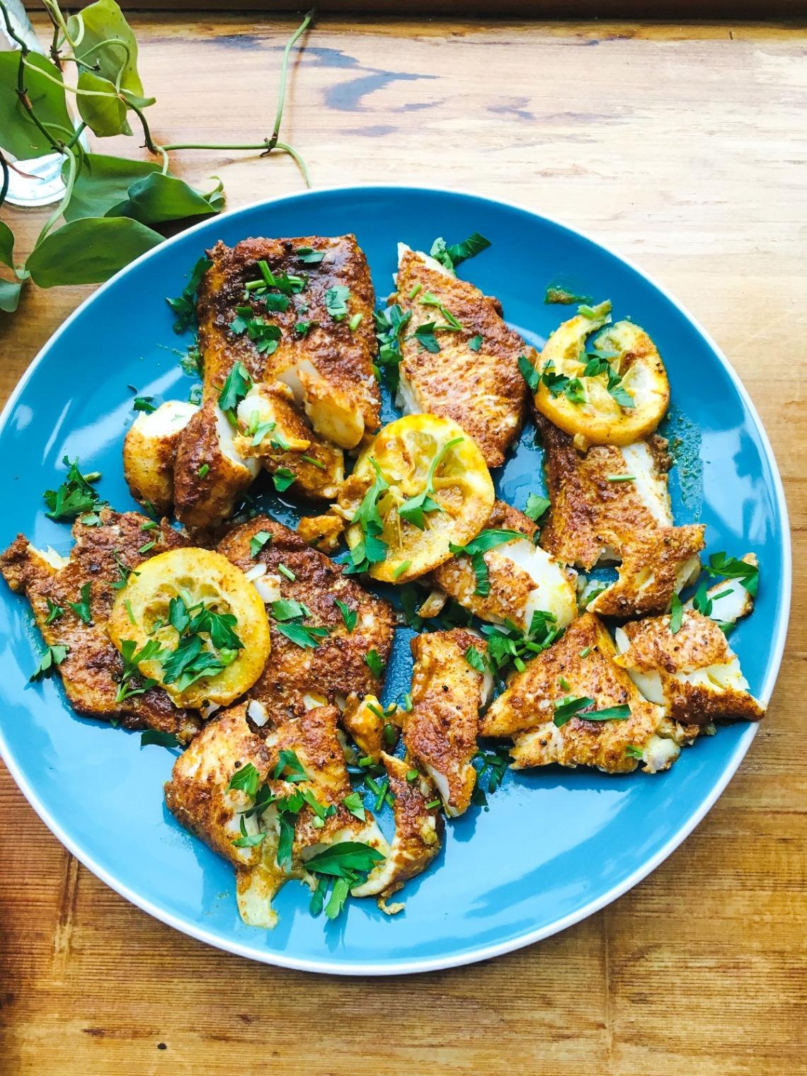 shawarma spiced cod with fresh parsley and lemon