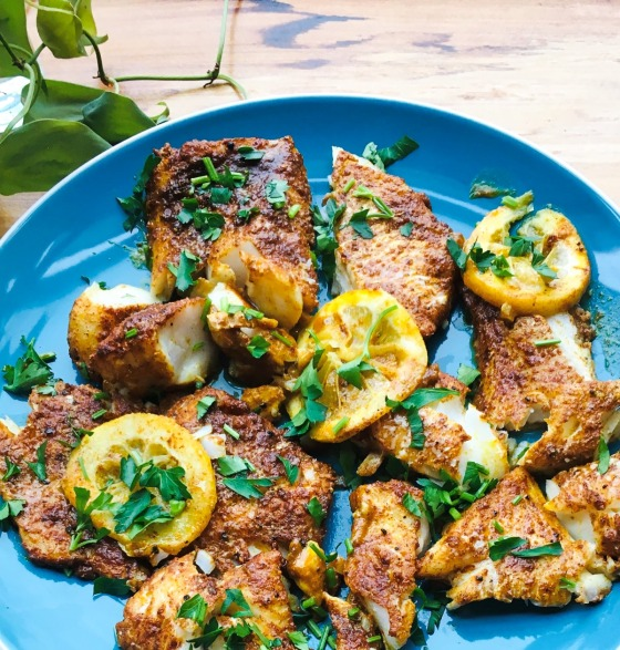 shawarma spiced cod with chopped fresh parsley and thinly sliced lemon