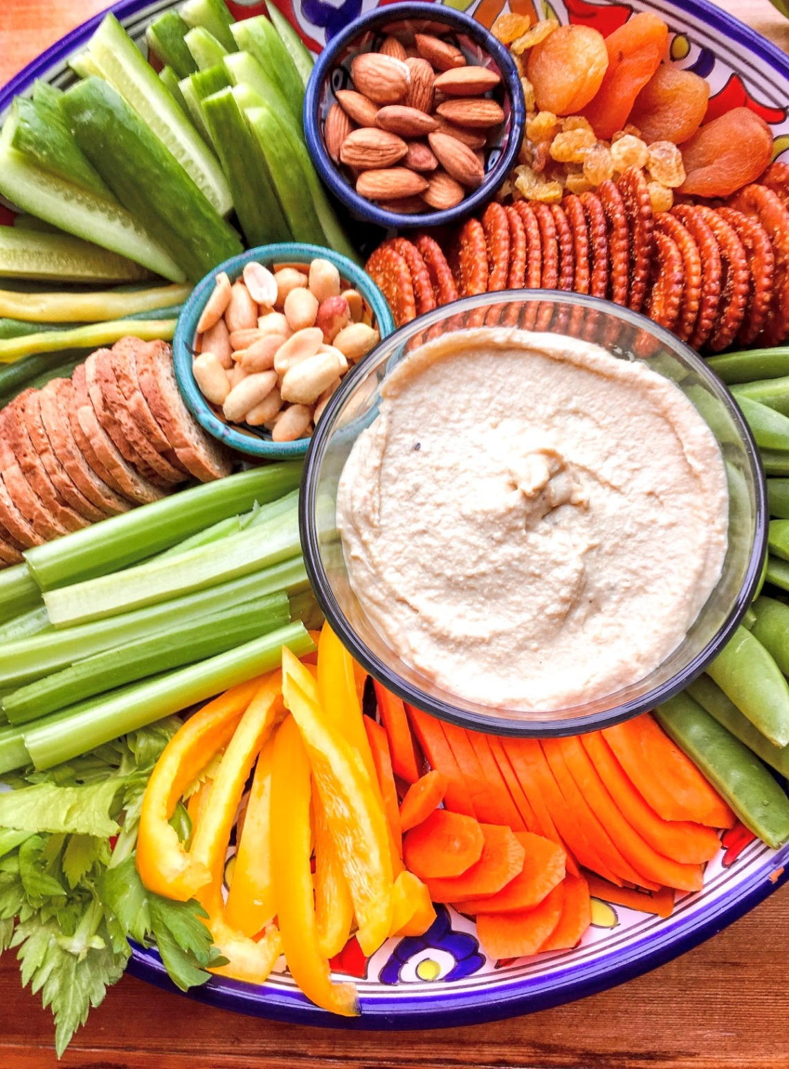 snack platter with veggies, crackers and hummus