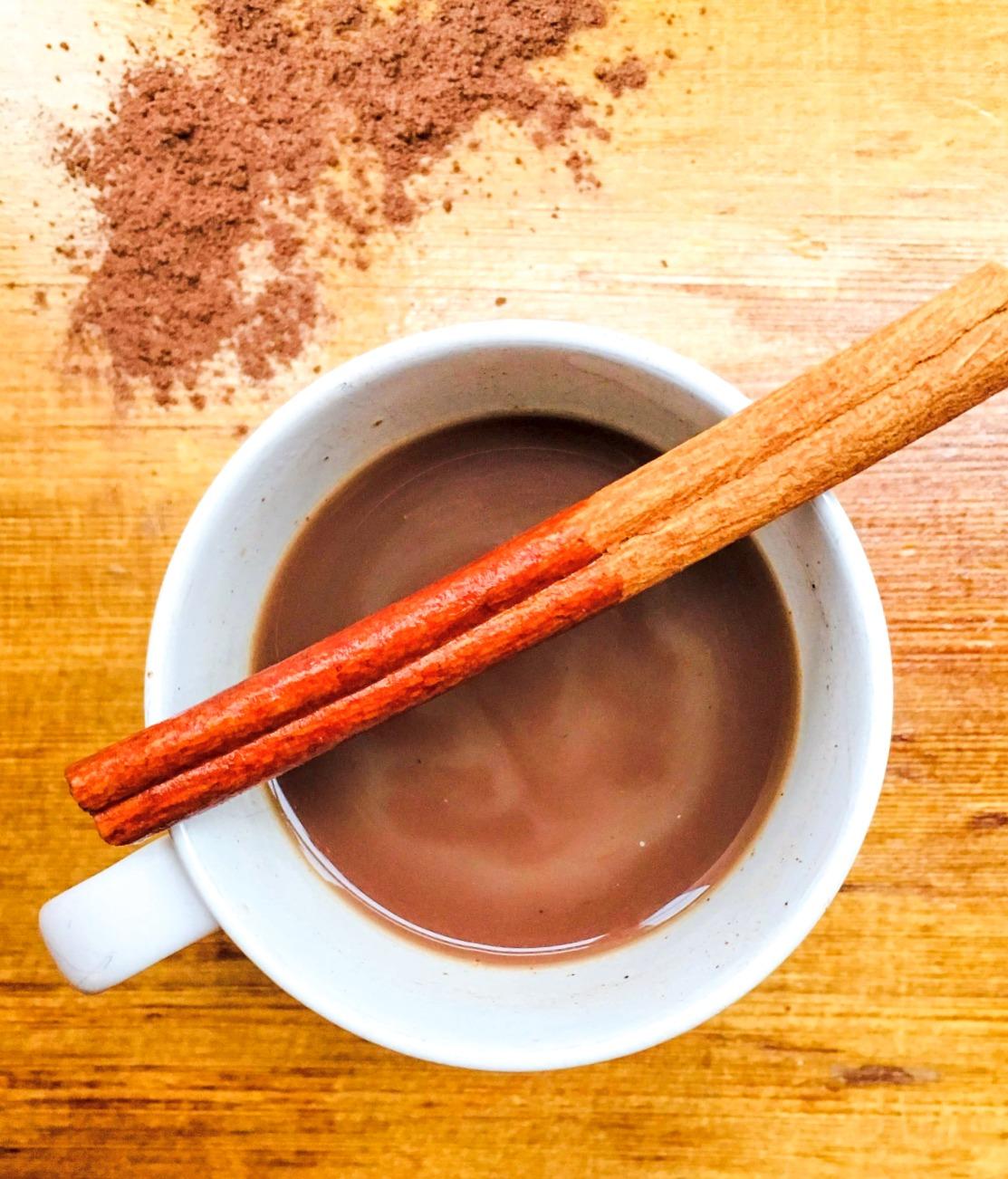 spiced cocoa tea with a cinnamon stick